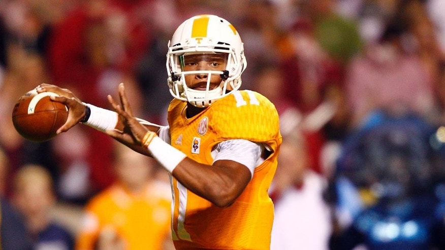 Tennessee quarterback Joshua Dobbs (11) throws to a receiver in the first quarter of an NCAA college football game against Alabama, Saturday, Oct. 25, 2014, in Knoxville, Tenn. (AP Photo/Wade Payne)