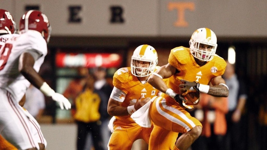 Tennessee running back Jalen Hurd (1) takes handoff from quarterback Nathan Peterman (12) in the first quarter of an NCAA college football game against Alabama, Saturday, Oct. 25, 2014, in Knoxville, Tenn. (AP Photo/Wade Payne)