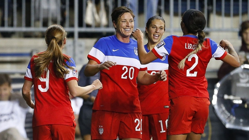 United States forward Abby Wambach (20) celebrates a goal with teammates Heather O'Reilly (9), Carli Lloyd (10) and Sydney Leroux in the second half against Costa Rica during the CONCACAF championship soccer match in Chester, Pa., Sunday, Oct. 26, 2014. The United States defeated Costa Rica 6-0. (AP Photo/Rich Schultz)