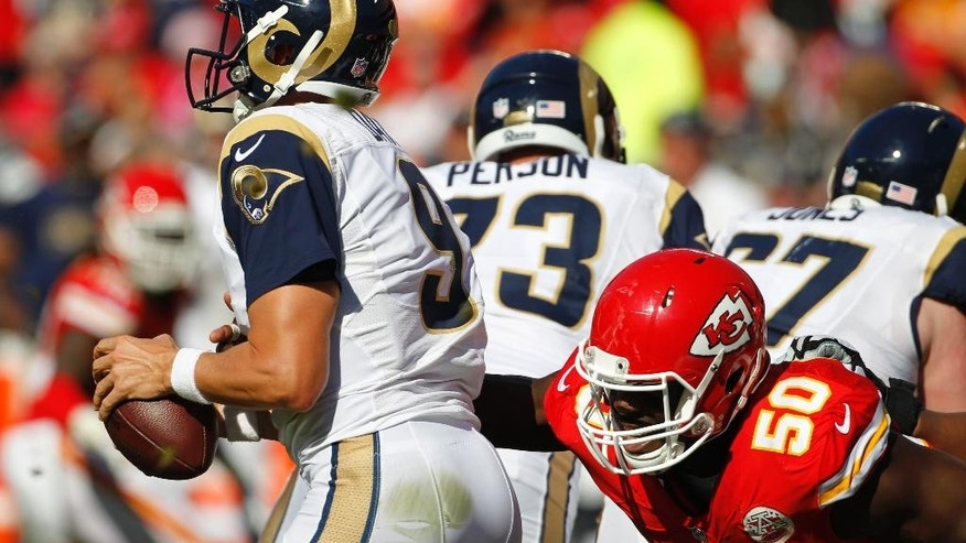 Kansas City Chiefs outside linebacker Justin Houston (50) sacks St. Louis Rams quarterback Austin Davis (9) in the second half of an NFL football game in Kansas City, Mo., Sunday, Oct. 26, 2014. (AP Photo/Colin E. Braley)