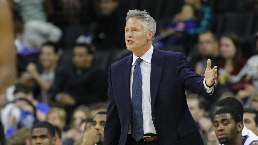 FILE - In this Oct. 18, 2014, file photo, Philadelphia 76ers' head coach Brett Brown gestures during an NBA preseason game against the Orlando Magic in Allentown, Pa. The 76ers lately can't seem to do anything right. They have botched trades, bumbled draft picks and tied a record for NBA futility last season with 26-straight losses. And it isn't shaping up to be much better this year.  (AP Photo/Rich Schultz, File)