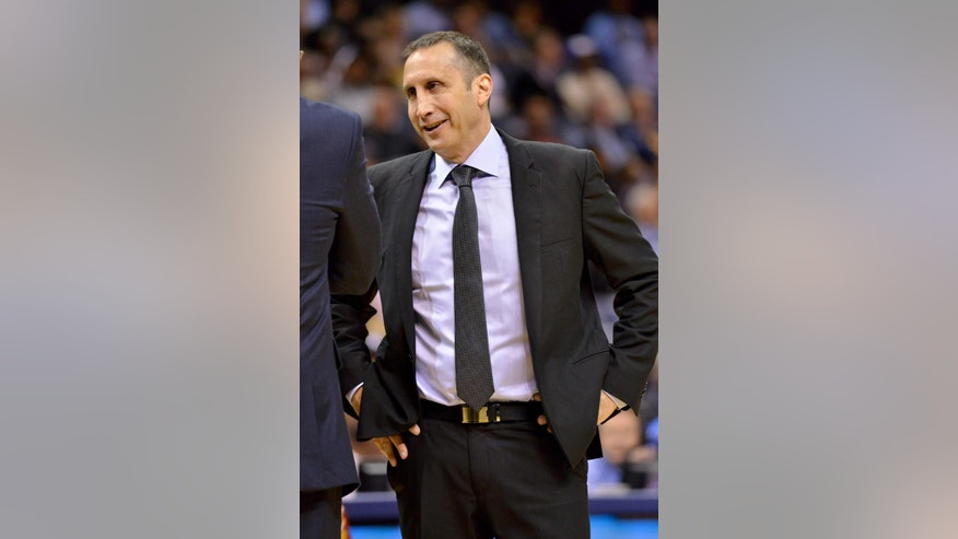Cleveland Cavaliers coach David Blatt talks during a timeout in the second half of a preseason NBA basketball game against the Memphis Grizzlies on Wednesday, Oct. 22, 2014, in Memphis, Tenn. The Grizzlies won 96-92. (AP Photo/Brandon Dill)