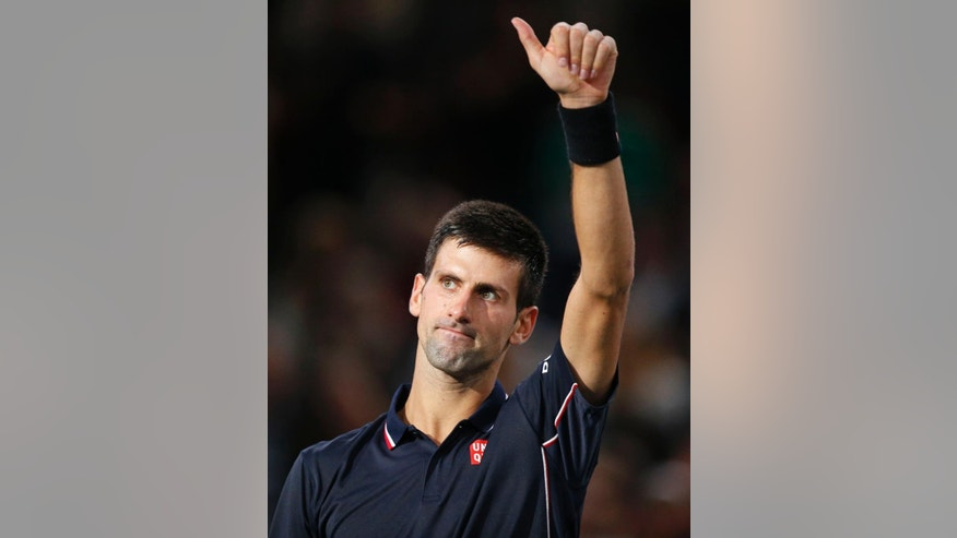 Serbia's Novak Djokovic acknowledges the crowd as he wins the second set against German Philipp Kohlschreiber after their first round match at the ATP World Tour Masters tennis tournament at Bercy stadium in Paris, France, Tuesday, Oct. 28, 2014. Djokovic won 6-3, 6-4. (AP Photo/Michel Euler)