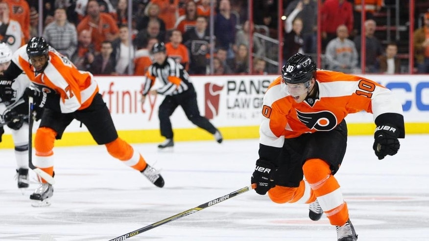Philadelphia Flyers' Brayden Schenn on the break away as he heads towards his overtime goal during the overtime period of an NHL hockey game against the Los Angeles Kings, Tuesday, Oct. 28, 2014, in Philadelphia. The Flyers won 3-2 in overtime. (AP Photo/Chris Szagola)