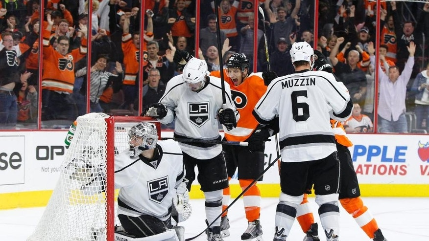 Philadelphia Flyers' Brayden Schenn, center, reacts to his overtime goal as Los Angeles Kings' Jonathan Quick, left, looks back for an official during the overtime period of an NHL hockey game, Tuesday, Oct. 28, 2014, in Philadelphia. The Flyers won 3-2 in overtime. (AP Photo/Chris Szagola)