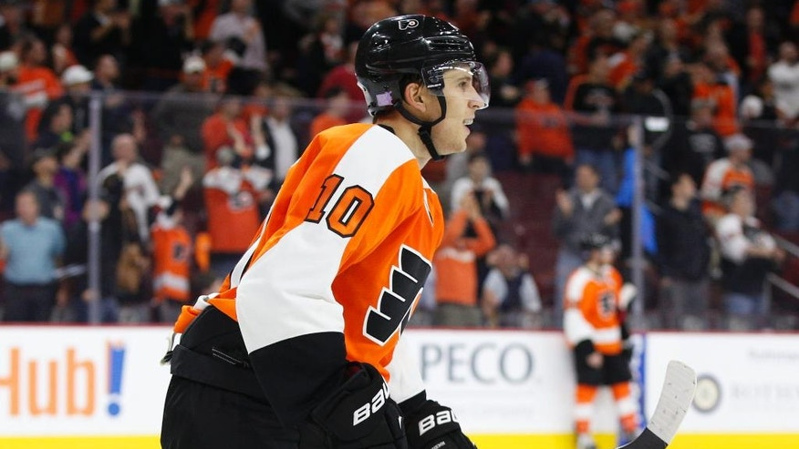 Philadelphia Flyers' Brayden Schenn reacts to watching the replay of his goal during the overtime period of an NHL hockey game against the Los Angeles Kings, Tuesday, Oct. 28, 2014, in Philadelphia. The Flyers won 3-2 in overtime. (AP Photo/Chris Szagola)