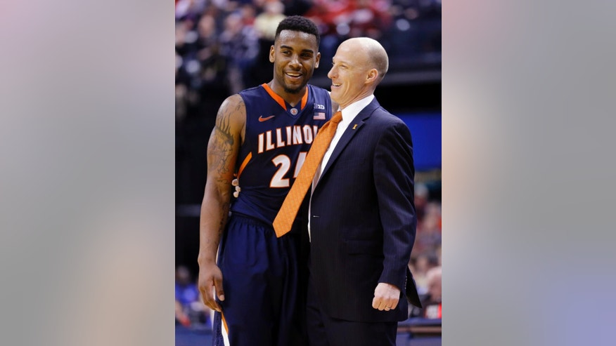 FILE - In this March 13, 2014 file photo, Illinois head coach John Groce, right, talks with guard Rayvonte Rice during an NCAA college basketball game against Indiana in the Big Ten Conference tournament in Indianapolis. Groce's expectations for this season are higher after failing to make the NCAA Tournament last year and settling for a spot in the National Invitation Tournament. Rice was last season's leading scorer. (AP Photo/Michael Conroy, File)