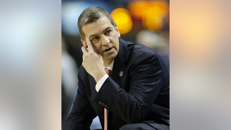 FILE - In this March 13, 2014 file photo, Maryland head coach Mark Turgeon looks toward the bench during a second round NCAA college basketball game against Florida State at the Atlantic Coast Conference tournament in Greensboro, N.C. Turgeon's fourth season at Maryland is shrouded in uncertainty for reasons that have little to do with the team's initial foray into the Big Ten. The Terrapins had five players, three of whom were starters, transfer during the offseason. (AP Photo/Gerry Broome, File)