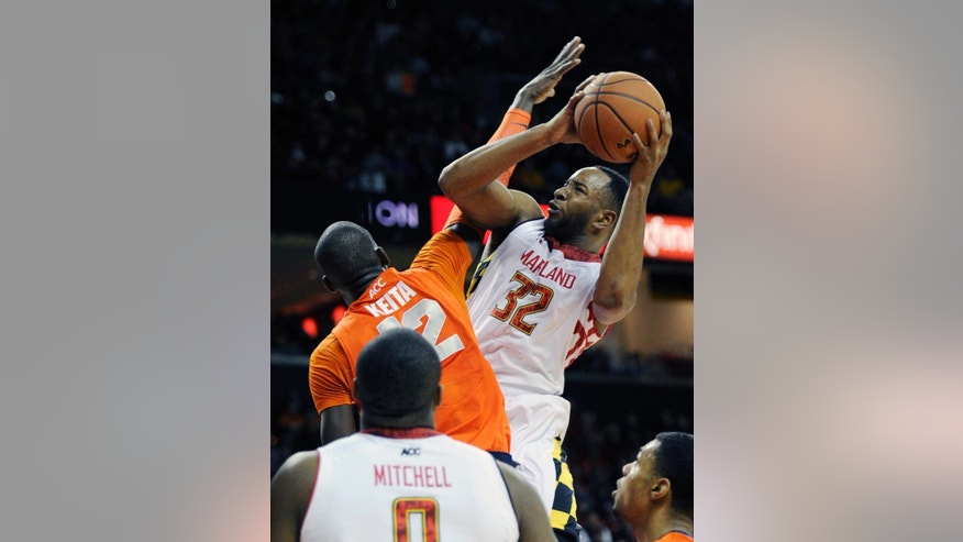 FILE - In this Feb. 24, 2014, file photo, Maryland's Dez Wells (32) is fouled by Syracuse center Baye-Moussa Keita (12) during an NCAA college basketball game in College Park, Md. Wells is one of only two returning scholarship guards to the team this season after a number of offseason transfers. (AP Photo/Nick Wass, File)