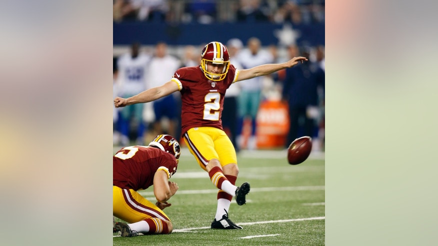 Washington Redskins punter Tress Way (5) holds as Redskins' Kai Forbath (2) kicks a field goal during overtime of an NFL football game against the Dallas Cowboys, Monday, Oct. 27, 2014, in Arlington, Texas. Washington won 20-17. (AP Photo/Tim Sharp)