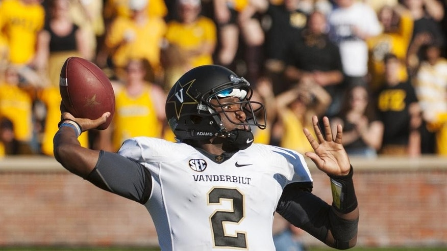 Vanderbilt quarterback Johnny McCrary throws a pass during the second quarter of an NCAA college football game against Missouri, Saturday, Oct. 25, 2014, in Columbia, Mo. (AP Photo/L.G. Patterson)