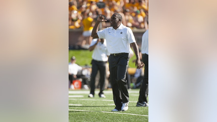Vanderbilt head coach Derek Mason shouts instructions to his team as they warm up before the start of an NCAA college football game Missouri, Saturday, Oct. 25, 2014, in Columbia, Mo. (AP Photo/L.G. Patterson)
