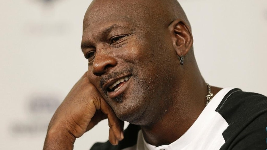 Charlotte Hornets owner Michael Jordan speaks to the media during a news conference about the NBA basketball team in Charlotte, N.C., Tuesday, Oct. 28, 2014. (AP Photo/Chuck Burton)