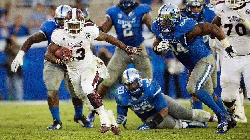 Mississippi State running back Josh Robinson breaks away from the Kentucky defense for a touchdown run during the second half of an NCAA college football game at Commonwealth Stadium in Lexington, Ky., Saturday, Oct. 25, 2014. Mississippi State won 45-31. (AP Photo/David Stephenson)