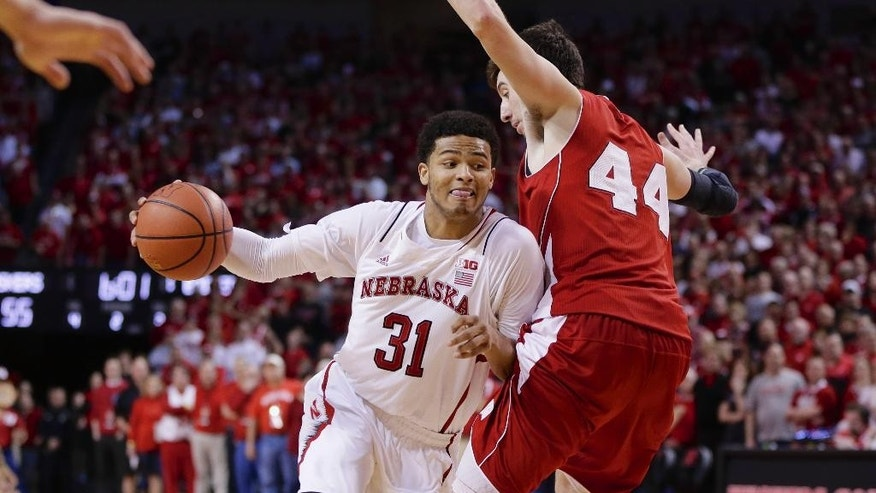 FILE - In this March 9, 2014, file photo, Nebraska's Shavon Shields (31) drives to the basket past Wisconsin's Frank Kaminsky (44) in the second half of an NCAA college basketball game in Lincoln, Neb. Nebraska was the surprise team in the Big Ten with its fourth-place finish last season, and coach Tim Miles believes he has the pieces in place for a big encore. (AP Photo/Nati Harnik, file)