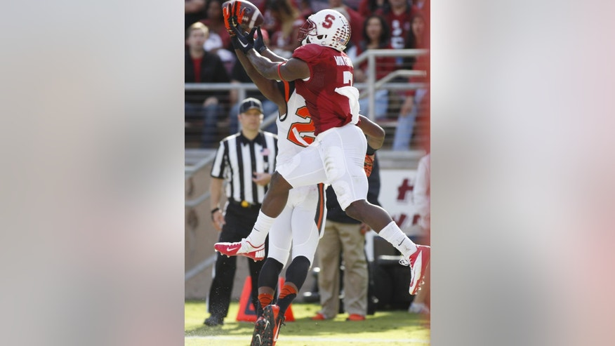 Oregon State's  Ryan Murphy, rear, breaks up a pass meant for Stanford's Ty Montgomery, front, during the second half of an NCAA  college football game, Saturday, Oct. 25, 2014 in Stanford, Calif. (AP Photo/George Nikitin)