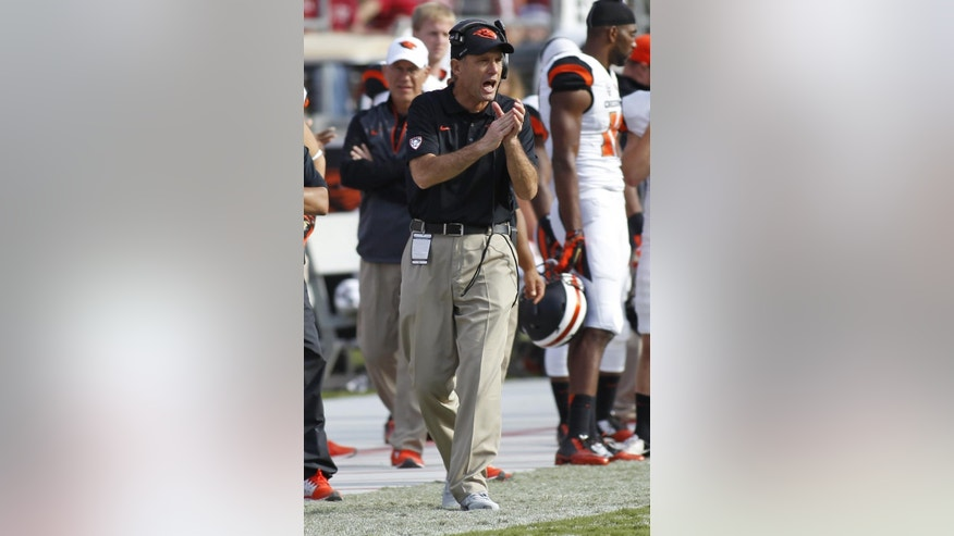 Oregon State head coach Mike Riley claps his hands during the second half of an NCAA  college football game against Stanford, Saturday, Oct. 25, 2014, in Stanford, Calif. (AP Photo/George Nikitin)