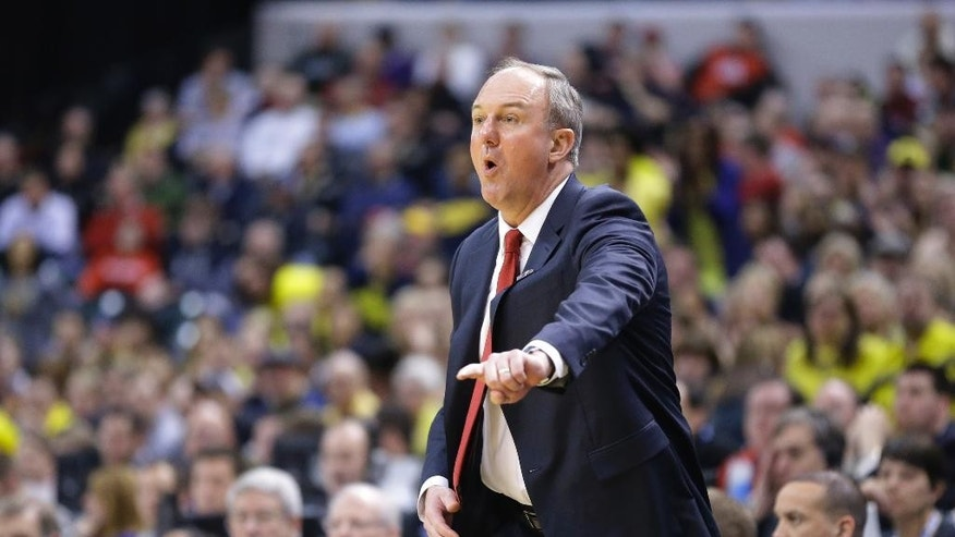 FILE - In this March 15, 2014, file photo, Ohio State head coach Thad Matta talks to his team during the first half of an NCAA college basketball game against Michigan in the semifinals of the Big Ten tournament in Indianapolis. Matta says he likes his 2014-15 club, even though he only has two returning starters from last season's team. (AP Photo/Michael Conroy, File)