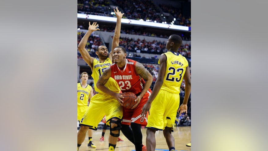 FILE - In this March 15, 2014, file photo, Ohio State center Amir Williams (23) drives to basket against Michigan forward Jon Horford (15) and guard Caris LeVert (23) during the semifinals of the NCAA Big Ten basketball tournament in Indianapolis. Williams and Sam Thompson are the Buckeyes' only returning starters as they prepare to start the 2014-15 season. (AP Photo/Michael Conroy, File)
