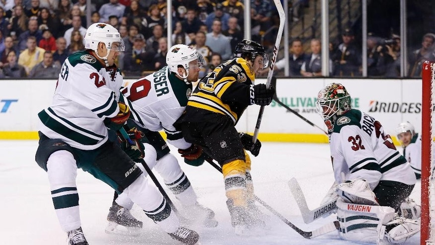 Boston Bruins' center Seth Griffin (53) scores on Minnesota Wild goalie Niklas Backstrom (32), of Finland, in the second period of an NHL hockey game in Boston, Tuesday, Oct. 28, 2014. (AP Photo/Michael Dwyer)
