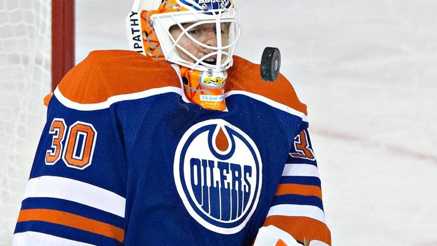 Edmonton Oilers goalie Ben Scrivens makes the save against the Montreal Canadiens during the second period of an NHL hockey game in Edmonton, Alberta, on Monday, Oct. 27, 2014. (AP Photo/The Canadian Press, Jason Franson)