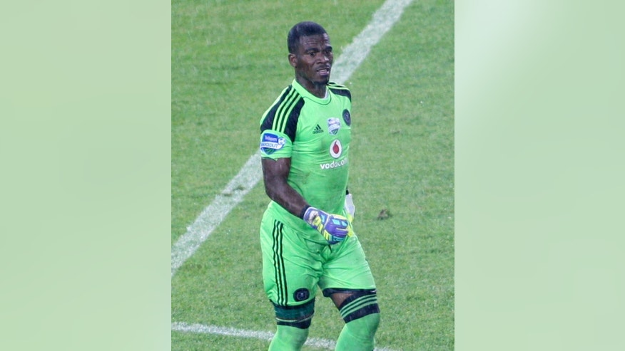 In this photo taken Saturday, Oct. 25, 2014, Orlando Pirates goalkeeper and captain of the national South African soccer team, Senzo Meyiwa during a match against Ajax in Soweto, Johannesburg.  Meyiwa was shot dead Sunday night at about 8pm at his girlfriend's Vosloorus home, east of Johannesburg. (AP Photo)
