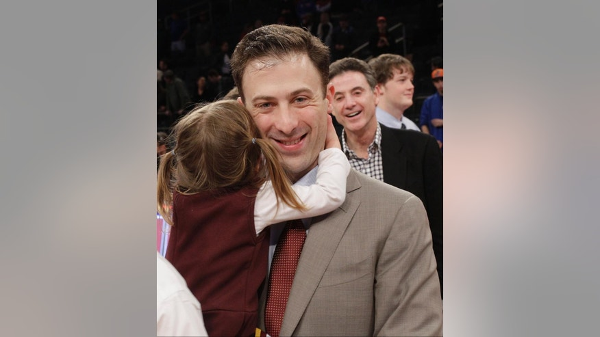 FILE - In this April 3, 2014, file photo, Minnesota coach Richard Pitino holds his daughter, Ava, as his father Rick Pitino, right, watches after Minnesota defeated SMU 65-63 in an NCAA college basketball game in the final of the NIT in New York. Minnesota returns with most of the same team intact but in a Big Ten conference that ought to be just as tough. (AP Photo/Frank Franklin II. File)