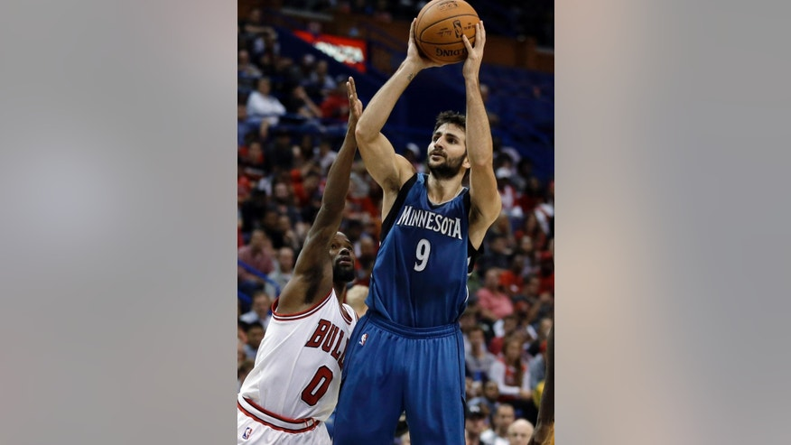 Minnesota Timberwolves' Ricky Rubio, right, shoots as Chicago Bulls' Aaron Brooks defends during the second half of a preseason NBA basketball game Friday, Oct. 24, 2014, in St. Louis. The Timberwolves won 113-112. (AP Photo/Jeff Roberson)
