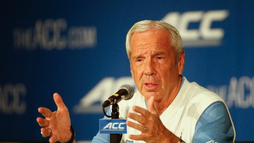 North Carolina basketball coach Roy Williams answers a question at the Atlantic Coast Conference NCAA college basketball media day in Charlotte, N.C., Wednesday, Oct. 29, 2014. (AP Photo/Nell Redmond)