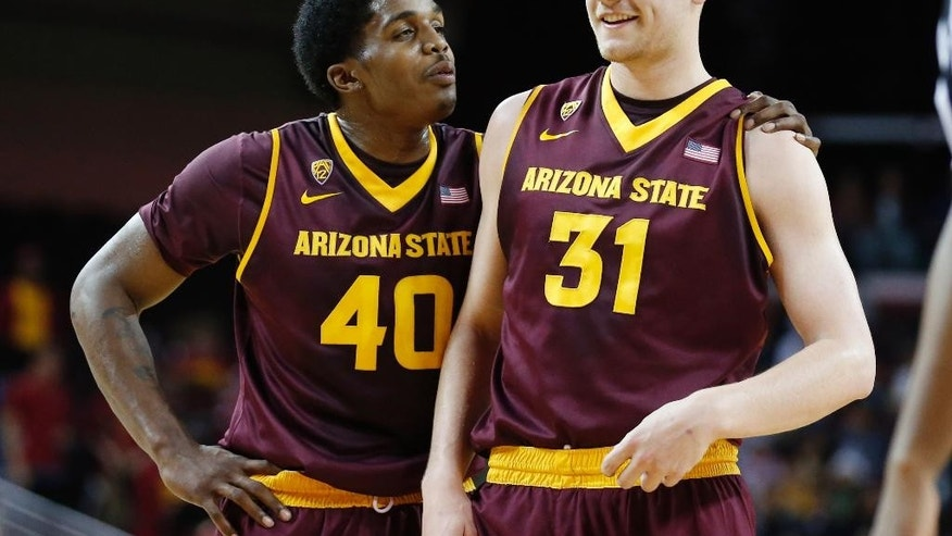 FILE - In this Jan. 9, 2014, file photo, Arizona State's Shaquielle McKissic, left, smiles with teammate Jonathan Gilling, right, before Gilling shot three free throws against Southern California during the first half of an NCAA college basketball game in Los Angeles. With Jahil Carson and Jordan Bachynski gone, the Sun Devils may have more questions than answers this season.  (AP Photo/Danny Moloshok, File)