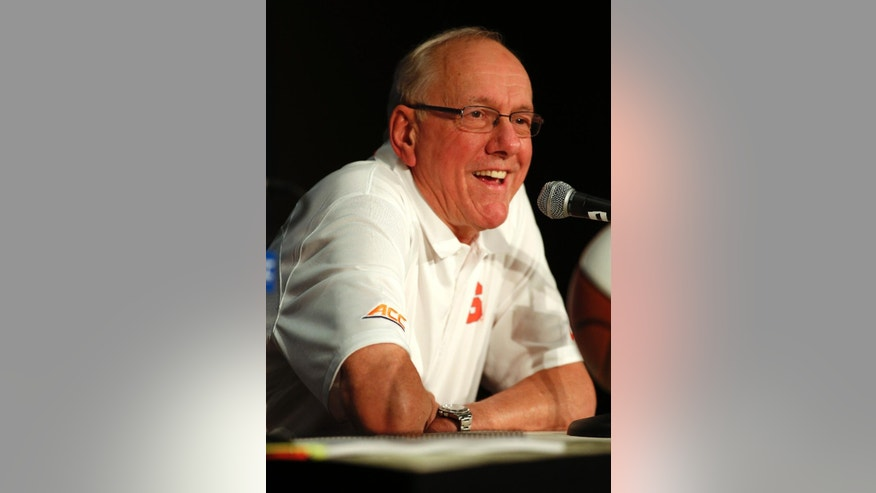 Syracuse basketball coach Jim Boeheim answers a question at the Atlantic Coast Conference NCAA college basketball media day in Charlotte, N.C., Wednesday, Oct. 29, 2014. (AP Photo/Nell Redmond)