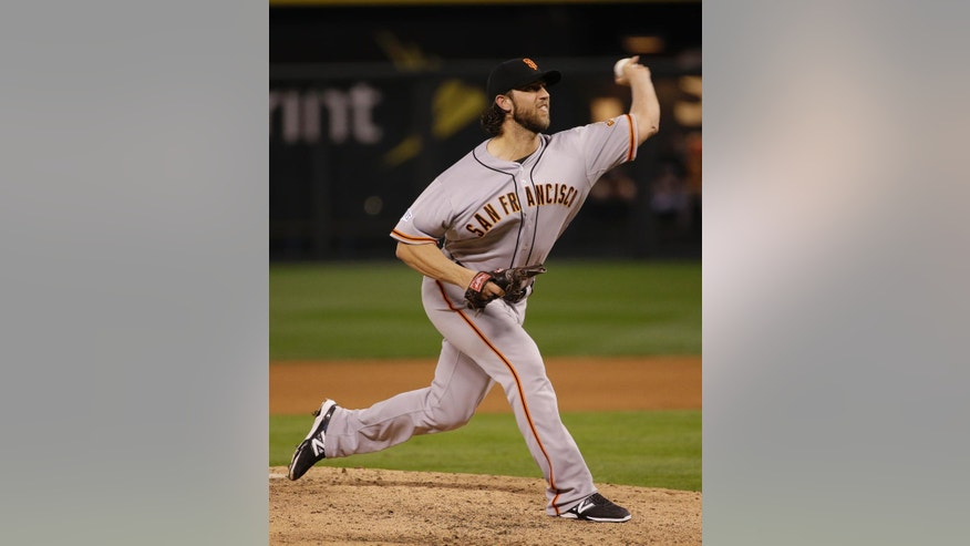 San Francisco Giants pitcher Madison Bumgarner throws during the fifth inning of Game 7 of baseball's World Series against the Kansas City Royals Wednesday, Oct. 29, 2014, in Kansas City, Mo. (AP Photo/Matt Slocum)