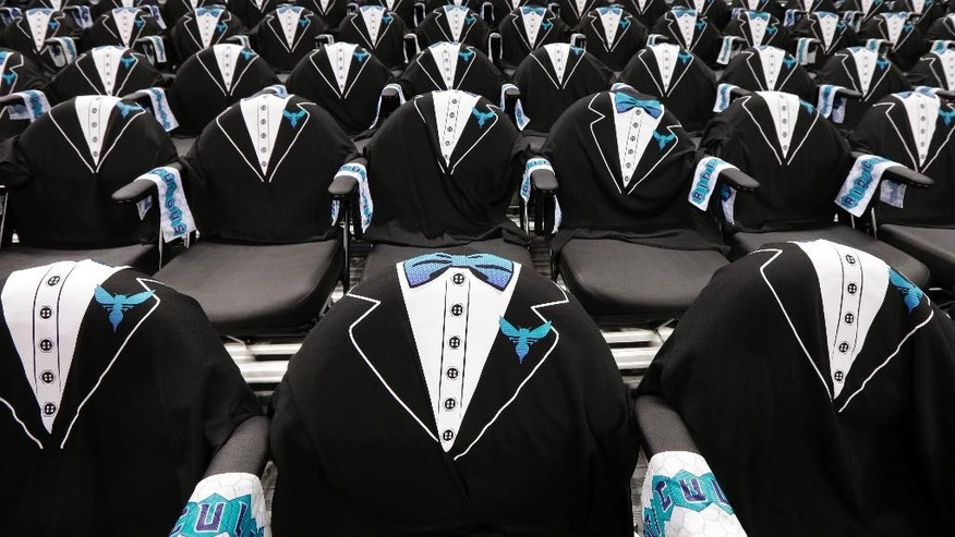 Tuxedo T-shirt are placed on every seat in Time Warner Cable Arena before an NBA basketball game between the Charlotte Hornets and the Milwaukee Bucks in Charlotte, N.C., Wednesday, Oct. 29, 2014. The game is the official opener for the renamed Charlotte Hornets, a return to the original NBA franchise name. (AP Photo/Chuck Burton)