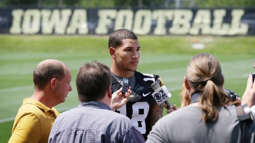 FILE - In this Aug. 4, 2014, file photo, Iowa freshman wide receiver Derrick Willies speaks to reporters during Iowa's annual college football media day in Iowa City, Iowa. Willies is leaving the program and sophomore running back LeShun Daniels Jr. is out for the rest of the season because of an undisclosed injury. Coach Kirk Ferentz says Willies is expected to transfer to be closer to his father, who is having health issues.  (AP Photo/Charlie Neibergall, File)