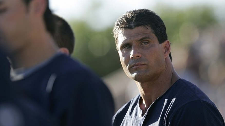 "CHICO, CA -  JULY 3:  Former Major League baseball player Jose Canseco of the San Diego Surf Dawgs is shown during a game against the Chico Outlaws July 3, 2006 in Chico, California. Canseco, the 1988 AL MVP whose autobiography ""Juiced"" 16 months ago accused several top players of steroid use, signed a contract with the unaffiliated Dawgs to be the designated hitter, and pitcher.  (Photo by David Paul Morris/Getty Images)"