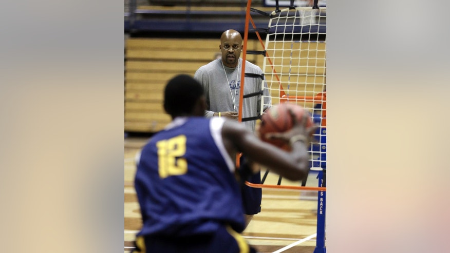California mens basketball coach Cuonzo Martin watches during practice Tuesday, Oct. 28, 2014, in Berkeley, Calif. After leaving Tennessee last spring, Martin succeeds Mike Montgomery, who retired after last season.  (AP Photo/Ben Margot)