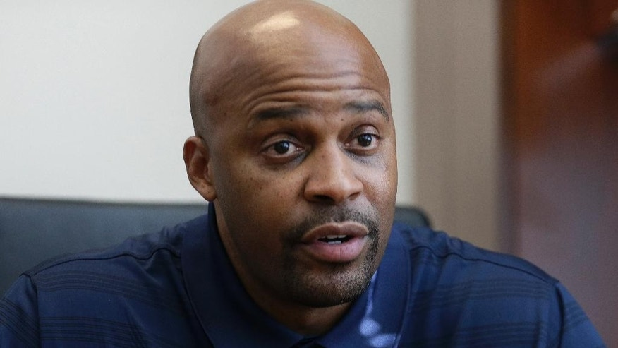 California mens basketball coach Cuonzo Martin gestures during an interview Tuesday, Oct. 28, 2014, in Berkeley, Calif. After leaving Tennessee last spring, Martin succeeds Mike Montgomery, who retired after last season. (AP Photo/Ben Margot)