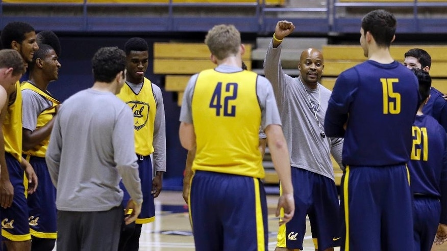 California mens basketball coach Cuonzo Martin raises his arm during practice Tuesday, Oct. 28, 2014, in Berkeley, Calif. After leaving Tennessee last spring, Martin succeeds Mike Montgomery, who retired after last season. (AP Photo/Ben Margot)