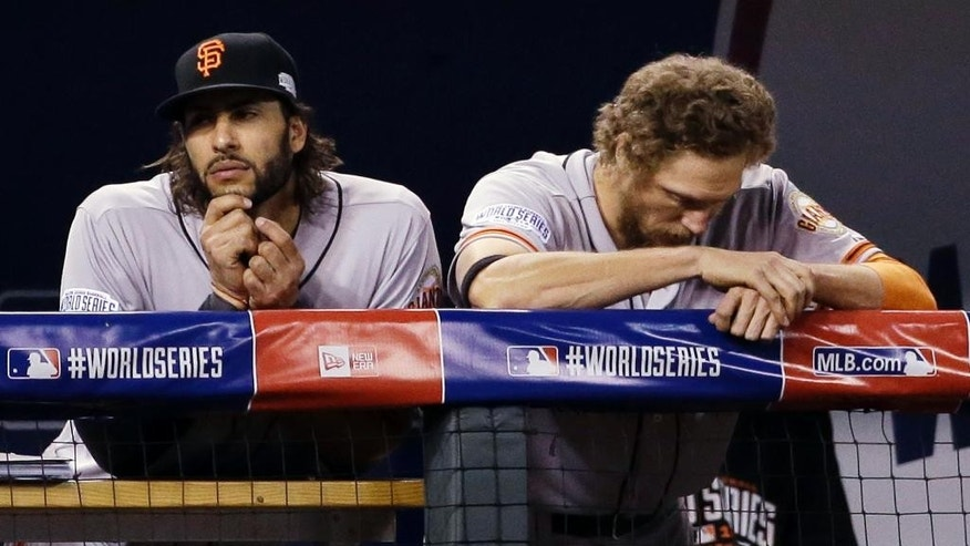 San Francisco Giants' Michael Morse, left, and Hunter Pence are seen in the dugout during the ninth inning of Game 6 of baseball's World Series against the Kansas City Royals Tuesday, Oct. 28, 2014, in Kansas City, Mo. The Royals won 10-0 to tie the series at 3-3. (AP Photo/David J. Phillip)