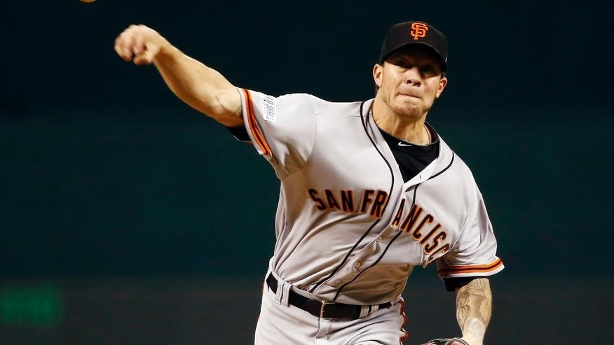 San Francisco Giants pitcher Jake Peavy throws during the first inning of Game 6 of baseball's World Series against the Kansas City Royals Tuesday, Oct. 28, 2014, in Kansas City, Mo. (AP Photo/Tannen Maury, Pool)