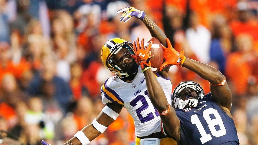 FILE - In this Oct. 4, 2014, file photo, Auburn wide receiver Sammie Coates (18) catches the ball for a touchdown against LSU defensive back Rashard Robinson (21) during the first half of an NCAA college football game in Auburn, Ala. The first of seven top-25 rankings done by a 12-member selection committee was released Tuesday, Oct. 28, 2014. Mississippi State, Florida State, Auburn, Mississippi are the top four teams in the first College Football Playoff rankings. (AP Photo/Brynn Anderson, File)
