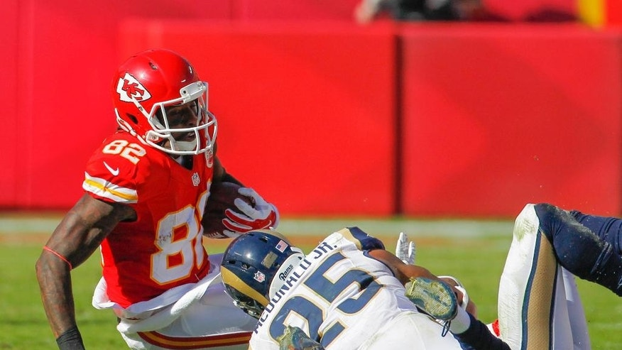 Kansas City Chiefs wide receiver Dwayne Bowe (82) is tackled by St. Louis Rams strong safety T.J. McDonald (25) in the second half of an NFL football game in Kansas City, Mo., Sunday, Oct. 26, 2014. The Kansas City Chiefs beat the St. Louis Rams 34-7. (AP Photo/Colin E. Braley)