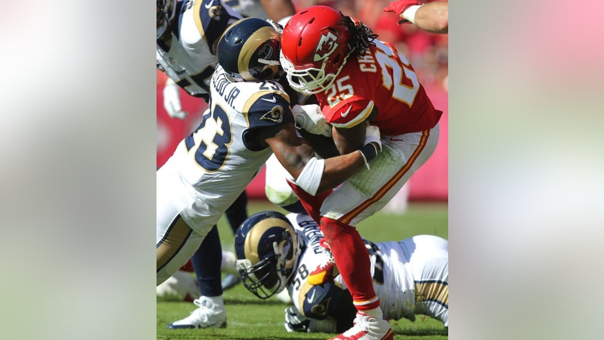 Kansas City Chiefs running back Jamaal Charles (25) is tackled by St. Louis Rams free safety Rodney McLeod (23) in the first half of an NFL football game in Kansas City, Mo., Sunday, Oct. 26, 2014. (AP Photo/Ed Zurga)