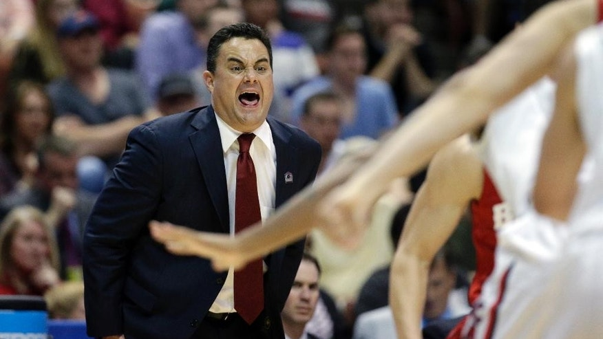 FILE - In this March 29, 2014, file photo, Arizona head coach Sean Miller yells during the first half in a regional final NCAA college basketball tournament game against Wisconsin, in Anaheim, Calif. Arizona lost two key contributors from that team: Guard and leader Nick Johnson, and athletic freshman forward Aaron Gordon. And yet, the Wildcats are considered on the short list of favorites to win this season's national title. (AP Photo/Jae C. Hong, File)