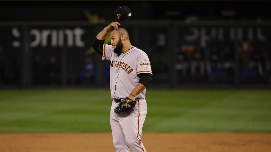 San Francisco Giants Yusmeiro Petit scratches his head after allowing a hit during the second inning of Game 6 of baseball's World Series against the Kansas City Royals Tuesday, Oct. 28, 2014, in Kansas City, Mo.(AP Photo/Matt Slocum)