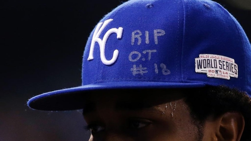 Kansas City Royals pitcher Yordano Ventura has an RIP O.T. #18 on his hat as he walks off the field during the first inning of Game 6 of baseball's World Series against the San Francisco Giants Tuesday, Oct. 28, 2014, in Kansas City, Mo. The writing was to honor St. Louis Cardinals outfielder Oscar Taveras who died Sunday in a car accident in his native Dominican Republic.(AP Photo/David J. Phillip)