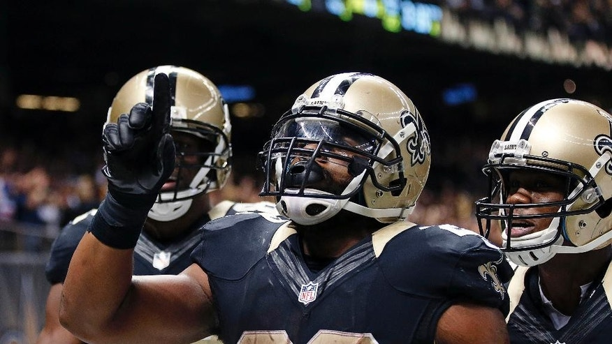 New Orleans Saints running back Mark Ingram (22) celebrates his touchdown in the second half of an NFL football game against the Green Bay Packers in New Orleans, Sunday, Oct. 26, 2014. The Saints won 44-23. (AP Photo/Rogelio Solis)
