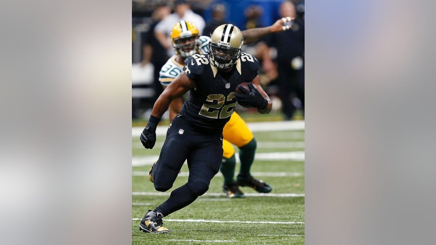 New Orleans Saints running back Mark Ingram (22) breaks loose on a touchdown carry in the second half of an NFL football game against the Green Bay Packers in New Orleans, Sunday, Oct. 26, 2014. (AP Photo/Rogelio Solis)