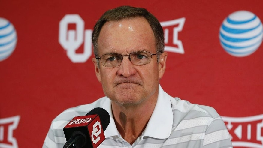 Oklahoma head coach Lon Kruger listens to a question during an NCAA college basketball media day in Norman, Okla., Monday, Oct. 27, 2014. (AP Photo/Sue Ogrocki)