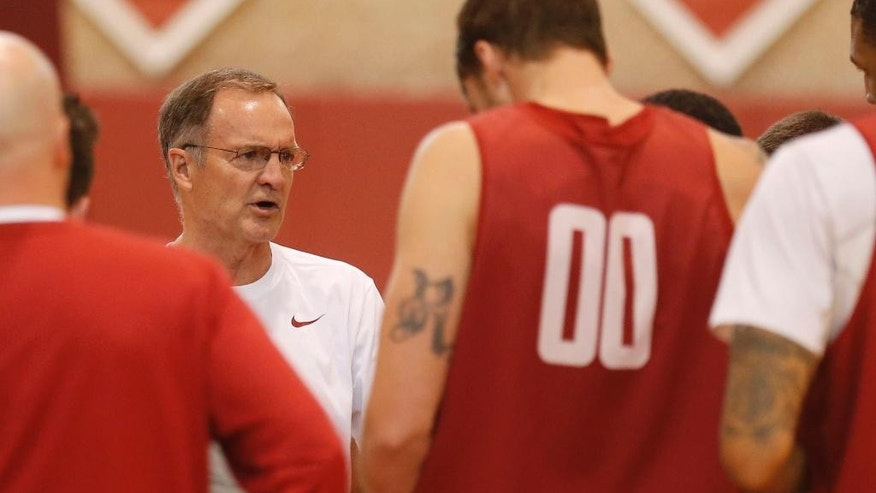 Oklahoma head coach Lon Kruger talks to his team during an NCAA college basketball practice in Norman, Okla., Monday, Oct. 27, 2014. (AP Photo/Sue Ogrocki)